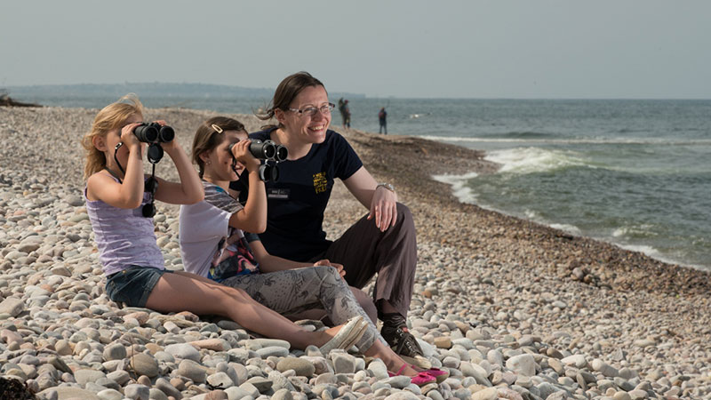 Things to see in Moray - Alison with visitors on Spey Bay beach