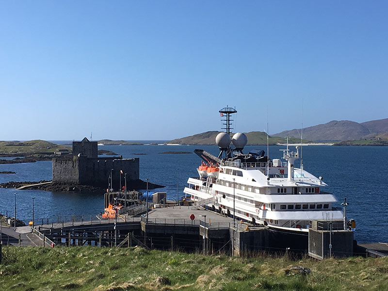 Kisimul Castle with cruise ship in foreground Barra island